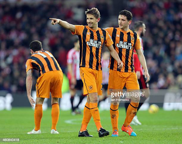 Gaston Ramirez of Hull City celebrates with Alex Bruce after Ramirez scored the first Hull goal during the Barclays Premier League match between...