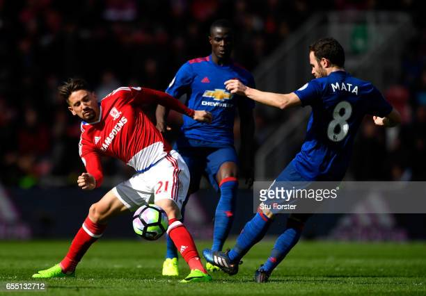 Gaston Ramirez of Middlesbrough battles with Eric Bailly of Manchester United and Juan Mata of Manchester United to keep possesion during the Premier...