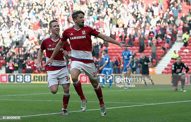 Gaston Ramirez of Middlesbrough celebrates scoring the opening goal with his team mate Adam Forshaw during the Premier League match between...