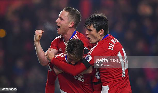 Gaston Ramirez of Middlesbrough celebrates with Adam Forshaw and Marten de Roon as he scores their first goal during the Premier League match between...