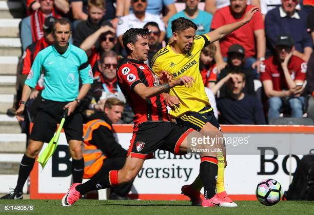 Gaston Ramirez of Middlesbrough clashes with Charlie Daniels of AFC Bournemouth leading to his red card during the Premier League match between AFC...