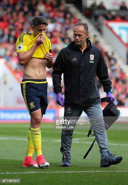 Gaston Ramirez of Middlesbrough leaves the pitch following an injury prior to recieving a red card during the Premier League match between AFC...