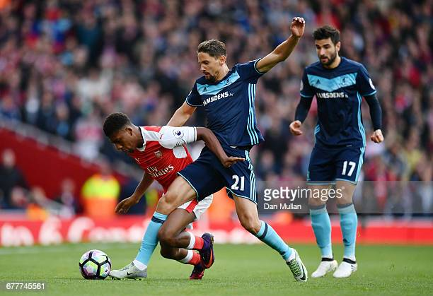 Gaston Ramirez of Middlesbrough tackles Alex Iwobi of Arsenal during the Premier League match between Arsenal and Middlesbrough at Emirates Stadium...