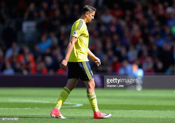 Gaston Ramirez of Middlesbrough walks off the pitch after being shown a red card during the Premier League match between AFC Bournemouth and...