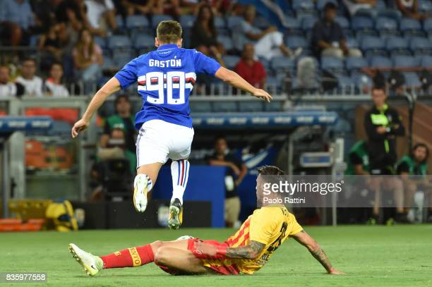 Gaston Ramirez of Sampdoria is tackled by Lorenzo Venuti of Benevento during the Serie A match between UC Sampdoria and Benevento Calcio at Stadio...
