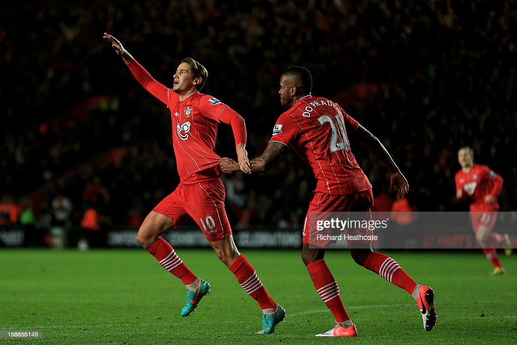 Gaston Ramirez (L) of Southampton celebrates with teammate <a gi-track='captionPersonalityLinkClicked' href=/galleries/search?phrase=Guly&family=editorial&specificpeople=3169598 ng-click='$event.stopPropagation()'>Guly</a> after scoring the opening goal during the Barclays Premier league match between Southampton and Arsenal at St Mary's Stadium on January 1, 2013 in Southampton, England.