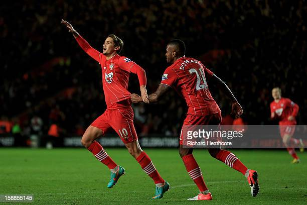 Gaston Ramirez of Southampton celebrates with teammate Guly after scoring the opening goal during the Barclays Premier league match between...