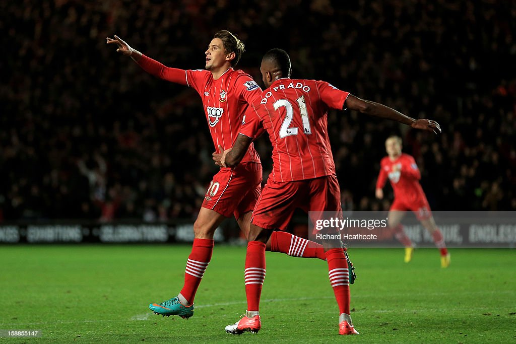 Gaston Ramirez (L) of Southampton celebrates with teammate Guly after scoring the opening goal during the Barclays Premier league match between Southampton and Arsenal at St Mary's Stadium on January 1, 2013 in Southampton, England.