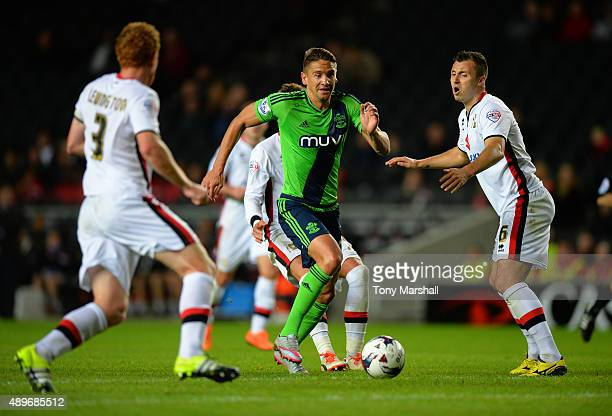 Gaston Ramirez of Southampton charges through the MK Dons defence during the Capital One Cup third round match between MK Dons and Southampton at...