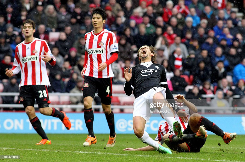 <a gi-track='captionPersonalityLinkClicked' href=/galleries/search?phrase=Gaston+Ramirez&family=editorial&specificpeople=6335880 ng-click='$event.stopPropagation()'>Gaston Ramirez</a> of Southampton is brought down by <a gi-track='captionPersonalityLinkClicked' href=/galleries/search?phrase=Wes+Brown+-+Soccer+Player&family=editorial&specificpeople=201876 ng-click='$event.stopPropagation()'>Wes Brown</a> of Sunderland during the Barclays Premier League match between Sunderland and Southampton at the Stadium of Light on January 18, 2014 in Sunderland, England.