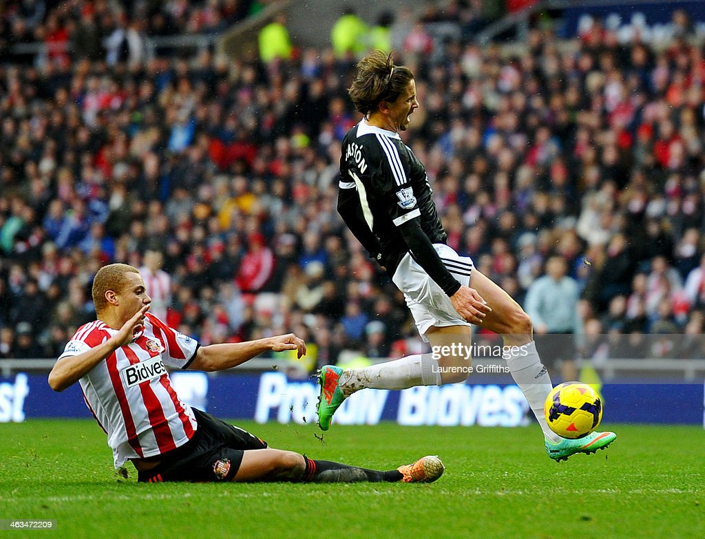 <a gi-track='captionPersonalityLinkClicked' href=/galleries/search?phrase=Gaston+Ramirez&family=editorial&specificpeople=6335880 ng-click='$event.stopPropagation()'>Gaston Ramirez</a> of Southampton is challenged by <a gi-track='captionPersonalityLinkClicked' href=/galleries/search?phrase=Wes+Brown+-+Soccer+Player&family=editorial&specificpeople=201876 ng-click='$event.stopPropagation()'>Wes Brown</a> of Sunderland during the Barclays Premier League match between Sunderland and Southampton at Stadium of Light on January 18, 2014 in Sunderland, England.