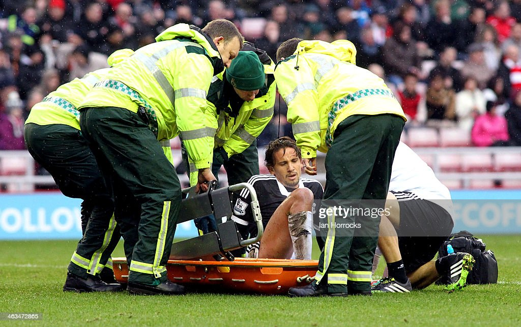 <a gi-track='captionPersonalityLinkClicked' href=/galleries/search?phrase=Gaston+Ramirez&family=editorial&specificpeople=6335880 ng-click='$event.stopPropagation()'>Gaston Ramirez</a> of Southampton is stretched off during the Barclays Premier League match between Sunderland and Southampton at the Stadium of Light on January 18, 2014 in Sunderland, England.