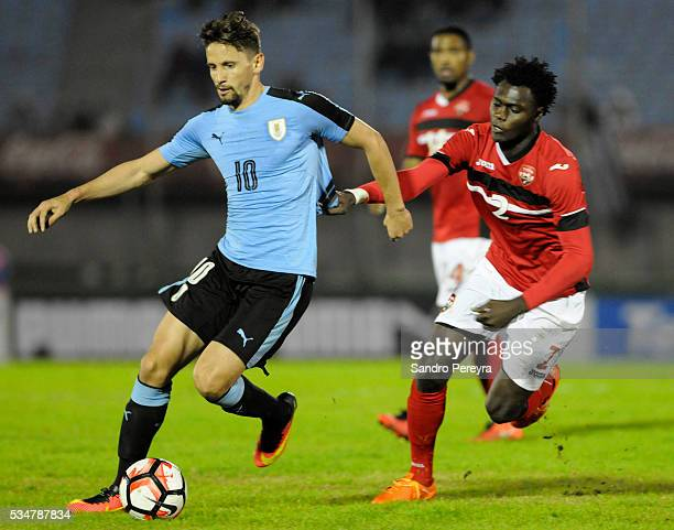 Gaston Ramirez of Uruguay and Aubrey David of Trinidad Tobago fight for the ball during an international friendly match between Uruguay and Trinidad...