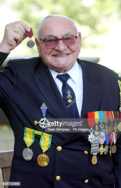 Gaston Sanz at the Imperial War Museum in London where he accepted a bravery award on behalf of his submarine's mascot Bacchus on the sixtieth...