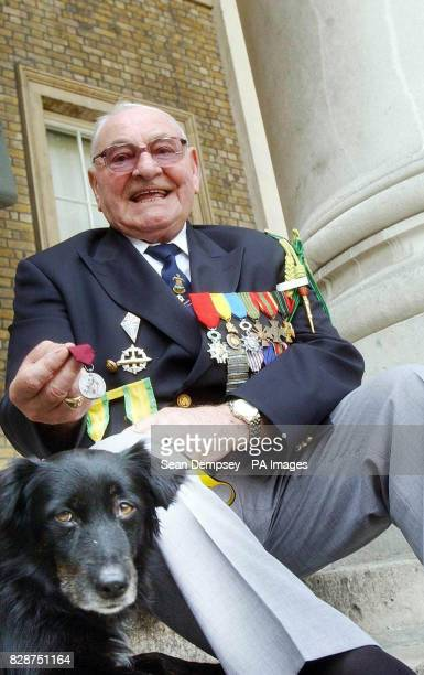 Gaston Sanz with National Canine Defence League s Angel at the Imperial War Museum in London where he accepted a bravery award on behalf of his...