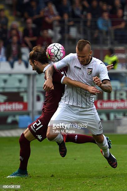 Gaston Silva of Torino and Aljaz Struna of Palermo compete for the ball during the Serie A match between Torino FC and US Citta di Palermo at Stadio...