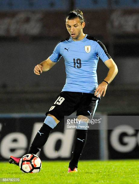 Gaston Silva of Uruguay drives the ball during an international friendly match between Uruguay and Trinidad Tobago at Centenario Stadium on May 27...