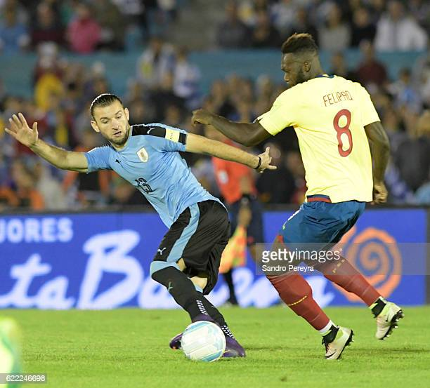 Gaston Silva of Uruguay fights for the ball with Felipe Caicedo of Ecuador during a match between Uruguay and Ecuador as part of FIFA 2018 World Cup...