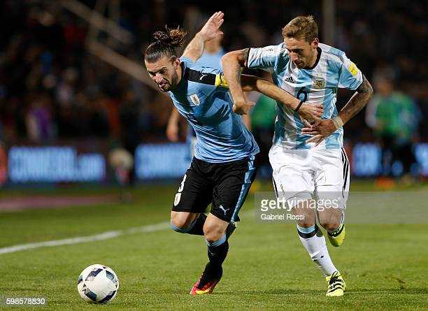 Gaston Silva of Uruguay fights for the ball with Lucas Biglia of Argentina during a match between Argentina and Uruguay as part of FIFA 2018 World...