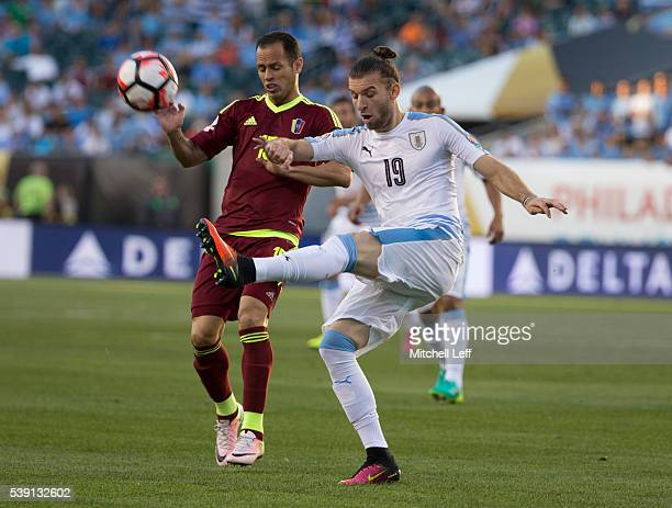 Gaston Silva of Uruguay kicks the ball against Alejandro Guerra of Venezuela during the 2016 Copa America Centenario Group C match at Lincoln...