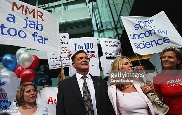 Gastroenterologist Dr Andrew Wakefield arrives with wife Carmel flanked by supporters on July 16 2007 on London England Wakefield is appearing before...