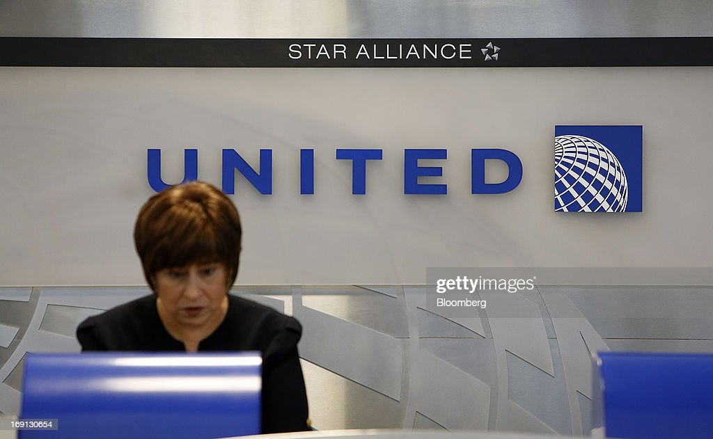 A gate agent works at the United Continental Holdings Inc. ticket counter at George Bush Intercontinental Airport in Houston, Texas, U.S., on Monday, May 20, 2013. Boeing Co.'s 787 Dreamliner is poised to clear another hurdle in restoring its image as United Airlines, the only U.S. operator, resumes flights after the jet's lithium-ion battery flaws forced a three-month grounding. Photographer: Aaron M. Sprecher/Bloomberg via Getty Images