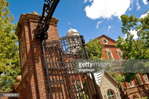 Gate and entrance to Harvard University campus in Cambridge, Massachusetts