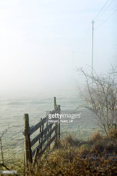 A gate in a hazy landscape, Sweden.