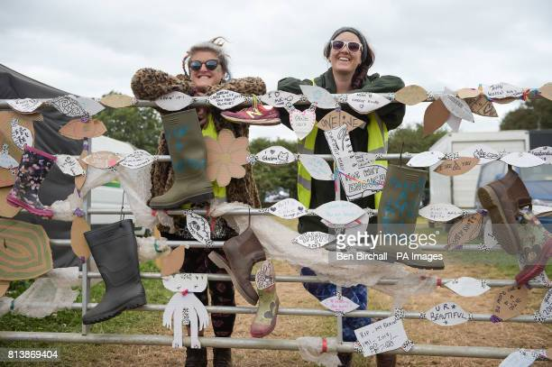 Gate marshalls stand by their decorated entrance at Glastonbury Festival Worthy Farm Somerset PRESS ASSOCIATION Photo Picture date Sunday June 2017...