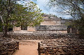 Gate to Maya Ek Balam with the fouindations of the defensive walls