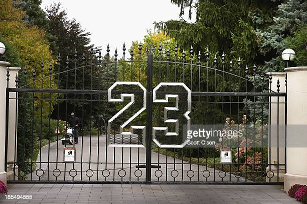 A gate with the number 23 controls access to the home of basketball legend Michael Jordan on October 21 2013 in Highland Park Illinois Twentythree is...