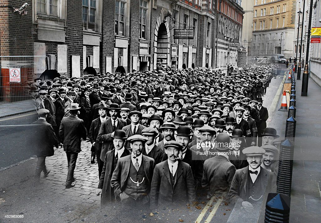 In this composite image a comparison has been made of Scotland Yard. Commemorations of The First World War Centenary begin in 2014 and will last until 2018. A gated barrier runs near Scotland Yard on March 17, 2014 in London, England. A number of events will be held this year to commemorate the centenary of the start of World War One. A large crowd of men respond to a call by the War Office for married men aged between 36 and 40 to become munition workers. They gathered outside the Inquiry Office at Scotland Yard in London, England during World War 1.