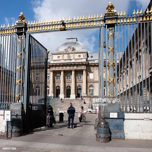 Gated entrance to the Palais de Justice the main courthouse in Paris France