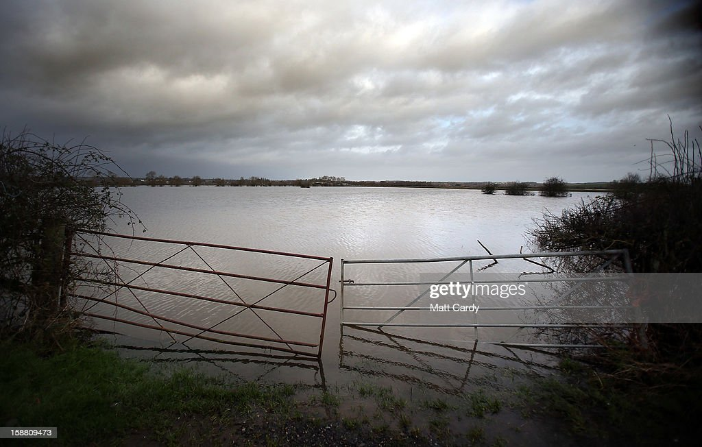 Gates lead into fields covered in flood waters surrounding the village of Muchelney, which has been cut off by flooding on the Somerset Levels, on December 30, 2012 near Langport, England. The Met Office is warning of the risk of further flooding towards the end of the year, meaning 2012 is set to be the wettest on record.