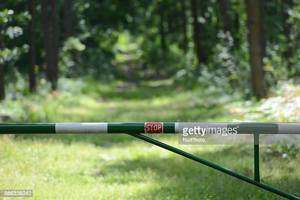 Gates with a 'Stop' sign preventing cars to enter inside 'Bor' forest in Krakow Poland on August 5 2016 The nature reserve 'Bor' is located near a...
