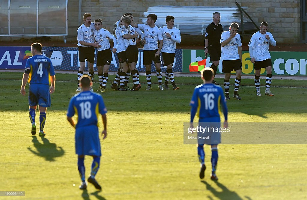 Gateshead players celebrate their second goal scored by Danny Wright during the FA Cup Second Round tie between Gateshead FC v and Warrington Town at the Gateshead International Stadium on December 7, 2014 in Gateshead, England.