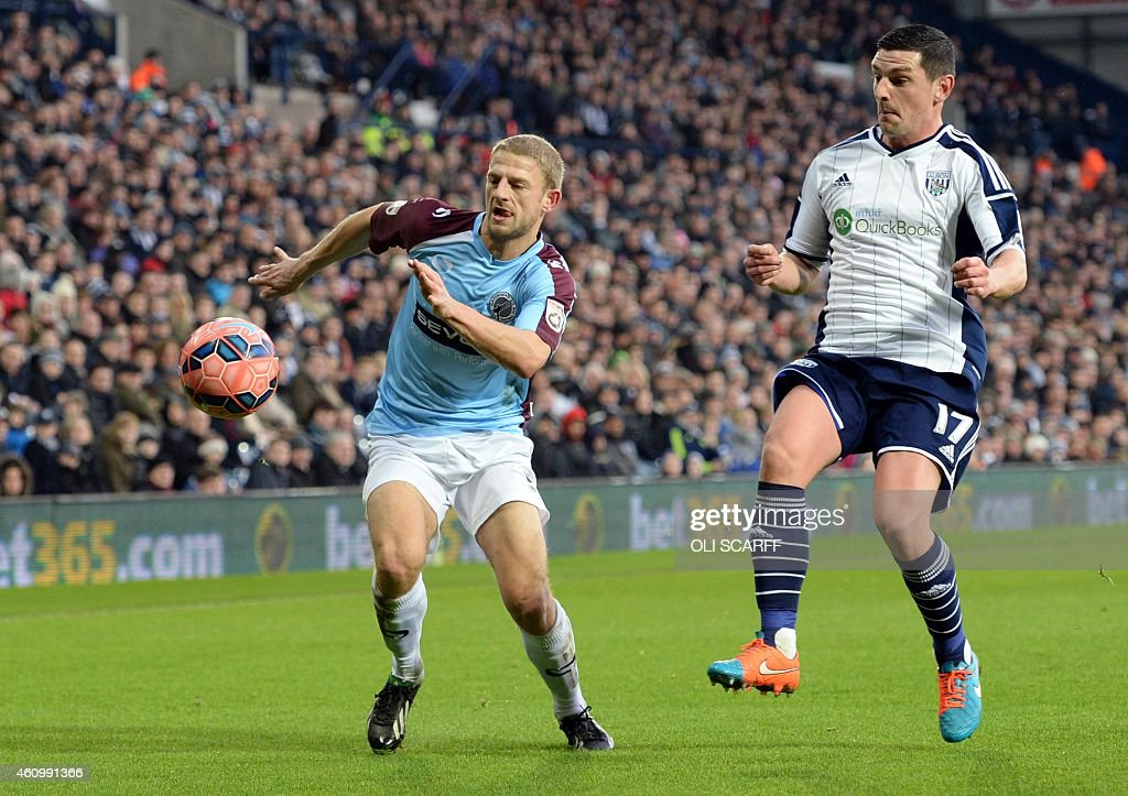 Gateshead's English Defender Craig Baxter vies with West Bromwich Albion's Scottish midfielder Graham Dorrans during the English FA Cup third round...