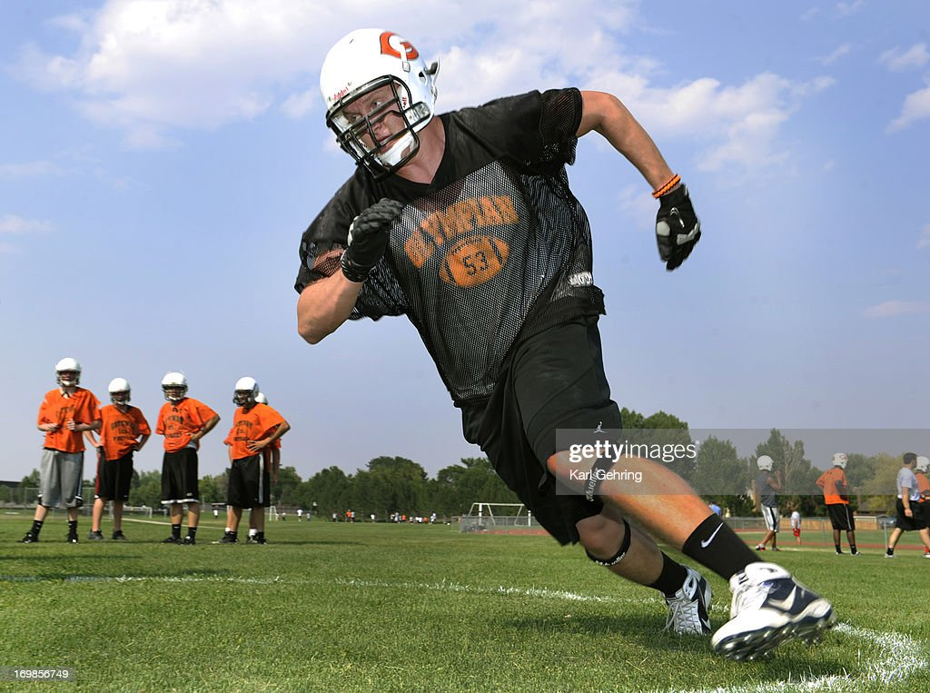Gateway High School lineman Zach Golditch ran through drills during practice Tuesday, August 14, 2012. Golditch was wounded in the Aurora theater shooting this summer. He was wounded below his left ear when a bullet entered and exited his neck while he was in the movie theater adjacent to the one in which alleged shooter James Holmes killed 12 people at the midnight screening of the Batman movie. Golditch still has bandages on the entrance wound.