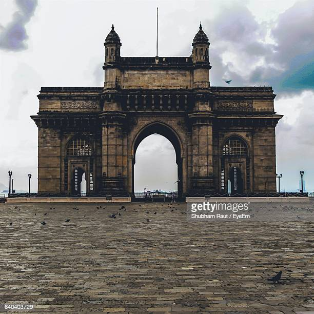 Gateway Of India Against Cloudy Sky