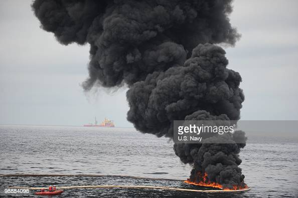 Gathered concentrated oil burns during a controlled oil fire May 5 2010 in the Gulf of Mexico The US Coast Guard oversaw the oil burn after the...