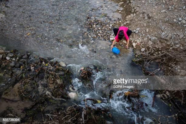 Gathering drinking water from a river in Beshkent Kyrgyzstan The water is vulnerable to contamination from trash and bacteria that cause hepatitis...