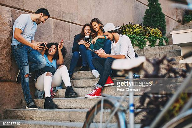 Gathering of young people with mobile phones