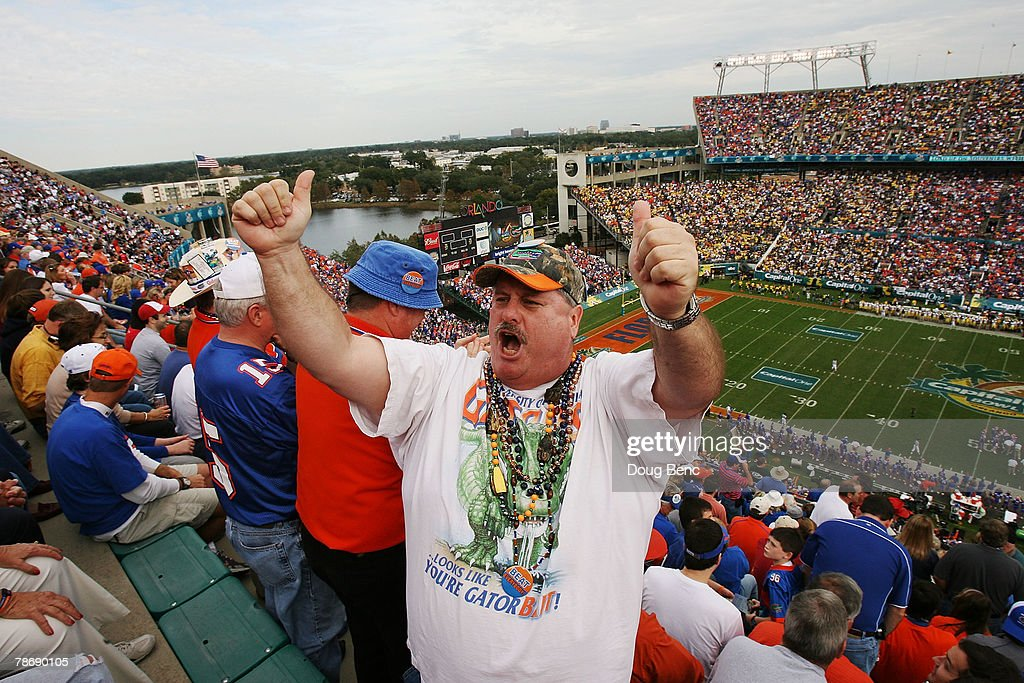 Gator Fan John Martin tries to get fans to cheer louder as the Michigan Wolverines take on the Florida Gators in the Capital One Bowl at Florida...