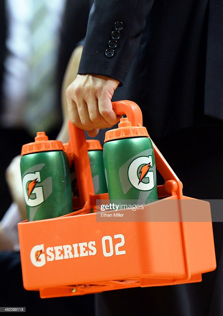 Gatorade sports bottles are carried near the Illinois Fighting Illini bench during a timeout in the team's game against the UNLV Rebels at the Thomas & Mack Center on November 26, 2013 in Las Vegas, Nevada. Illinois won 61-59.