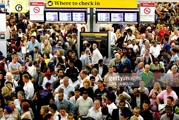 Crowds of people wait in the checkin area of the South terminal at Gatwick Airport 10 August 2006 in Sussex MI5 Britain's Intelligence Service has...