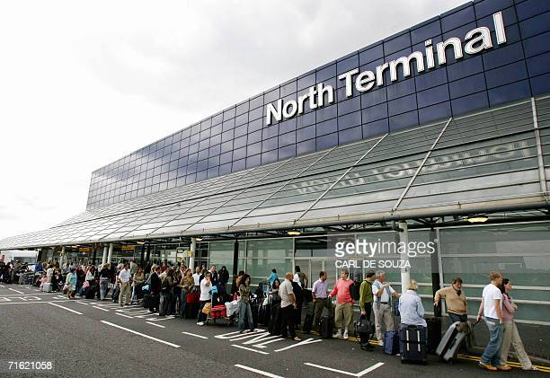 Crowds queue outside North terminal at Gatwick Airport Sussex 10 August 2006 MI5 Britain's Intelligence Service has upgraded the National Secuirty...
