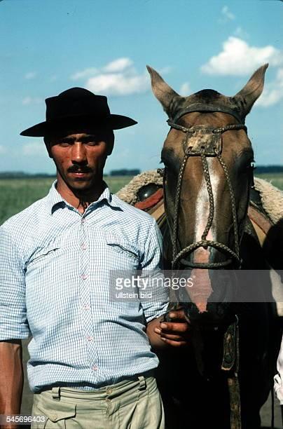 Gaucho mit PferdoJ
