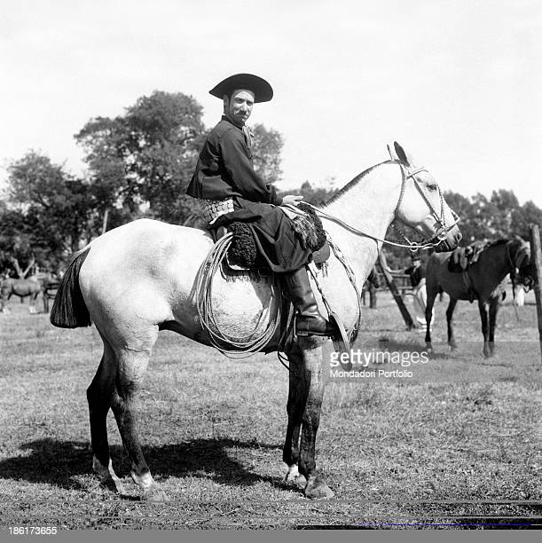 A gaucho on horseback in the typical outfit gauchos are the typical South American cattlemen the equivalent of North American cowboys found in the...