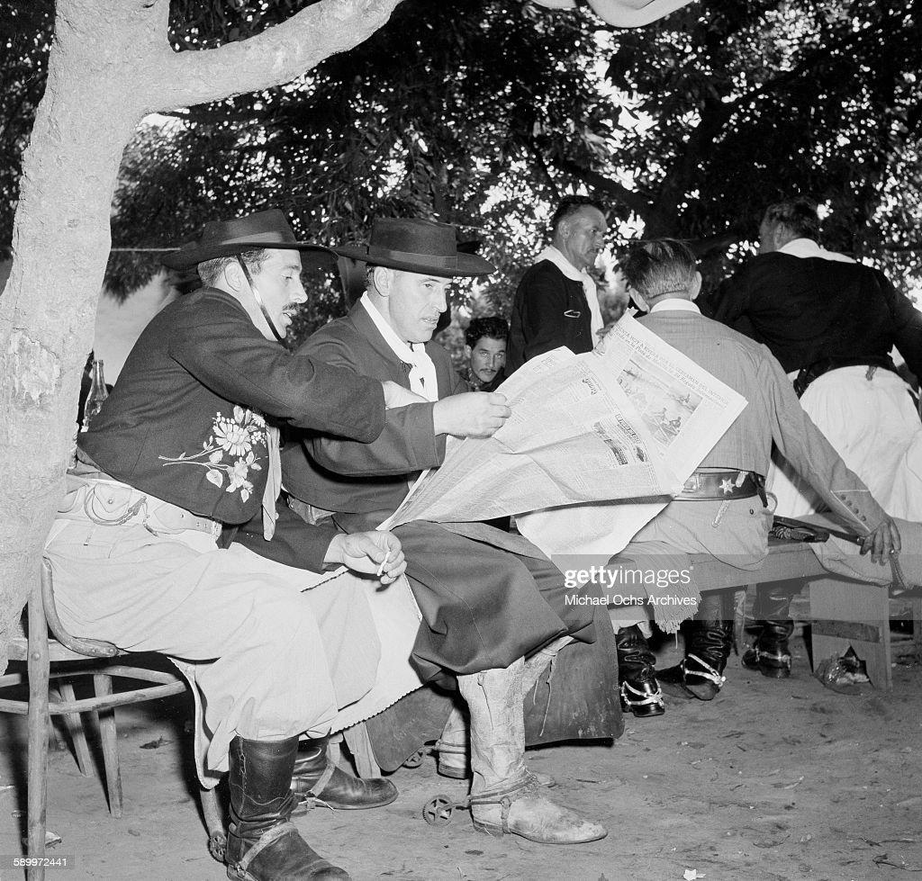 Gaucho rest before the Prada Criolla Rodeo in the Patria Grande Festival in Montevideo Uruguay