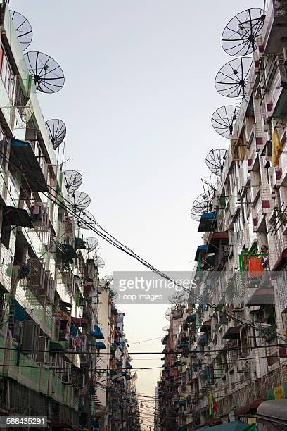 A gaunt grey street lined with satellite dishes in downtown Yangon in Myanmar